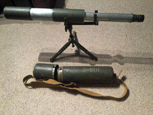 Telescope on tripod stand and the carrying case.