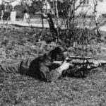 WWII British sniper in the regular prone shooting position. WBSTTR - Shore 1948 FP 119 BOTTOM