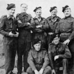 Some of the staff of the sniping school in Germany, during July-August 1945. The Scottish bonnets are those of the Lovat Scouts with blue and white dicing. Author Captain C. Shore is in the centre of the back row. WWII British snipers WBSTTR - Shore 1948 FP 134