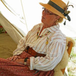 Fort Nisqually Brigade Days 2016 AUG (21) - Sue Morhun relaxing at her tent.