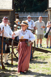 Fort Nisqually Brigade Days 2016 AUG (55) Sue Morhun welcoming a new recruit for the Fur Brigade.