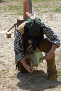 Fort Nisqually Brigade Days 2016 AUG (81) - Starting fire with flint and steel. He succeeded,