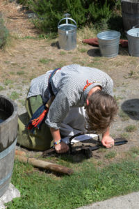 Fort Nisqually Brigade Days 2016 AUG (87) - Setting a beaver trap.