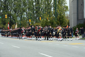 (13) The Seaforth Highlanders of Canada approaching the Seaforth Armoury. The Commanding Officer is on the viewer's right to take up his position front and centre when he halts the parade.