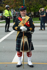 (38) Drum Major standing easy on parade on Burrard Street.