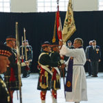 Padre Jim Short returning the Colours to the Colour Party after the Drumhead Ceremony. The Seaforths received the new Battle Honour of AFGHANISTAN.