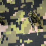 (404) Rappellers on the way down with C6 General Purpose Machine Guns sling. The C6 is a 7.62 variant of the FN MAG.