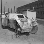 Ferret Scoyut car with front right wheel blown off by a land mine.