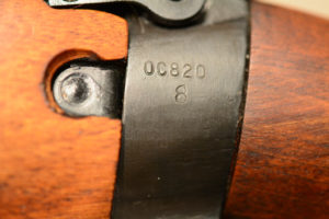 """Socket showing the serial number 0C820 over the U.S. Ordnance flaming bomb. No year here. The early Stevens-Savage rifle had the year on the left sidewall (1941 or 1942). These 1,403 rifles did not have the """"TR"""" stamp."""