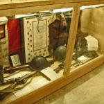 "Case 6B Seaforth Museum in 2008. Italian items. 2"" Mortar. CANLOAN tunic of Sandy Millar who was posted to the Imperial Seaforths in WWII."