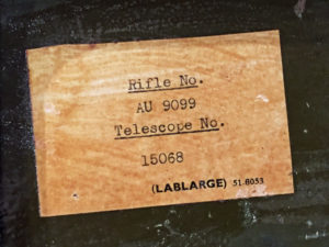 British No. 8 MK. I steel case for No. 32 Telescope showing the rifle serial number (AU9099) and scope serial number (15068) type on a label glued inside.