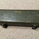 British No. 8 MK. I stell case for No. 32 Telescope showing the rifle serial number (AU9099) stencilled on top.