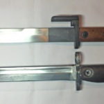 FN X2 E1 bayonet on top and FN C1 bayonet below.