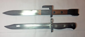FN X2 E1 bayonet on top and FN C1 bayonet below.