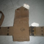 1914 MILLS webbing set for Colt 1911 Commercial pistol, one of 5,000 purchased by Canada in 1914, serial number C13085. Back view of the magazine pouch showing the Canadian issue mark C/|"|150|150|?|False|cfe0b982d5ddc7005cf1c03c1b8a6f98|False|UNLIKELY|0.3226863741874695