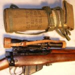1931 Lee-Enfield No. 4 MK. I (T) TRIALS F.T.R., matching in-service No. 32 MKL.3 scope SN 25455 and remained in service until 1963. - Rifle and matching scope case.