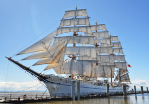 Sailing ship with all sails deployed.