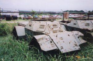 Derelict Ferret SWcout Car in a surplus yard.