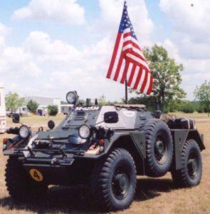 Restored Ferret Scout Car with big American flag.