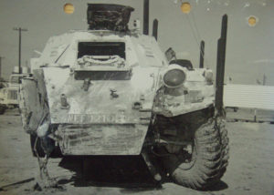 View of front of a Ferret Scout Car after a mine blew the front right wheel off.