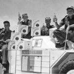 Soldiers in Ferret UNEF1209 loading cases of Carling beer onto their Ferret. (RCD Archives)