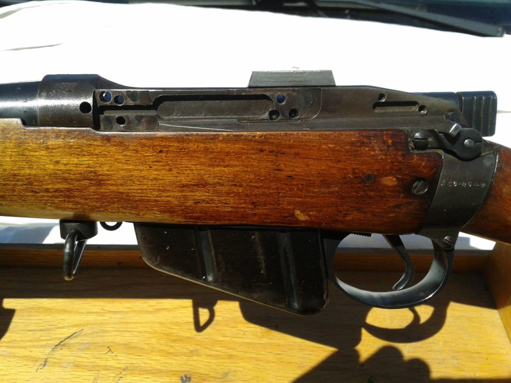 Left side of rifle body.