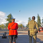 """Here comes your ride Sir!"" Two RCMP members awaiting the arrival of the RCMP helicopter."