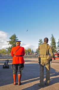 """""""Here comes your ride Sir!"""" Two RCMP members awaiting the arrival of the RCMP helicopter."""