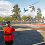RCMP Officer photographing the landing of the RCMP helicopter at Swangard Stadium. (D90 031)