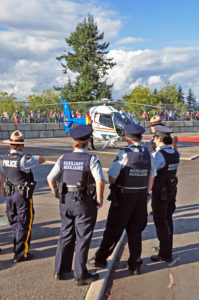 """They only issue us Auxiliaries bicycles."" RCMP members looking at the RCMP helicopter."