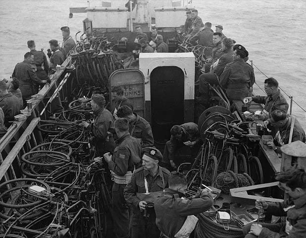 Soliders and bicycles on a landing ship enroute to the D-Day invasion beaches.