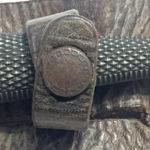 Snap fastener on knife scabbard.