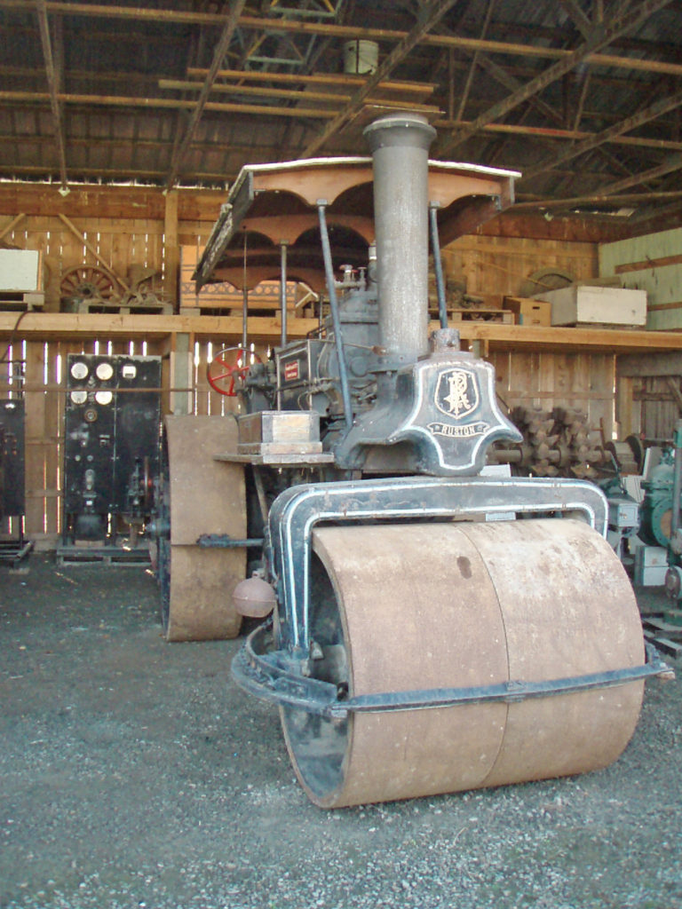 Steam roller in a museum shelter.