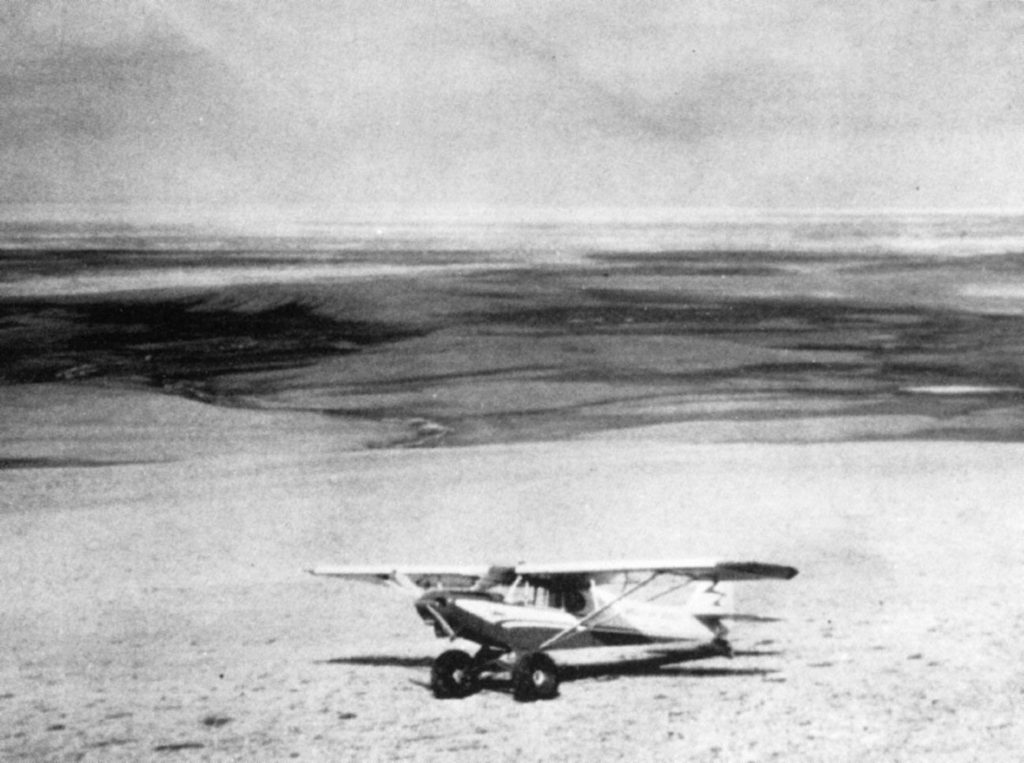 Small airplane on the ground in the Arctic summer.