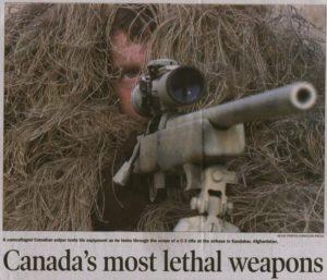 Sniper aiming his C3A1 sniper rifle