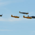 A gaggle of WWII aircraft. Left to right: Corsair (Erickson Collection), Harvard (Yellow Thunder Harvard Team), Me-109 (Spanish built version, Erickson Collection), Harvard (Yellow Thunder Harvard Team) and Hellcat (Erickson Collection). BBAS 2018. Photo by Colin MacGregor Stevens.