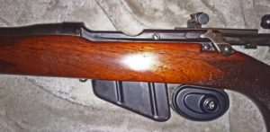 Second rifle which has no serial number. Left side with wood furniture in place.