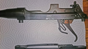 """Rifle serial number J-5550-16 and has a mid-war 2-position """"L"""" backsight. Left side showing the special trigger hung from the body instead of the trigger guard."""
