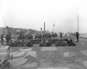 Loading Ferrets into HMCS Bonaventure enroute to Cyprus. 1964 (Photo HS-74490)