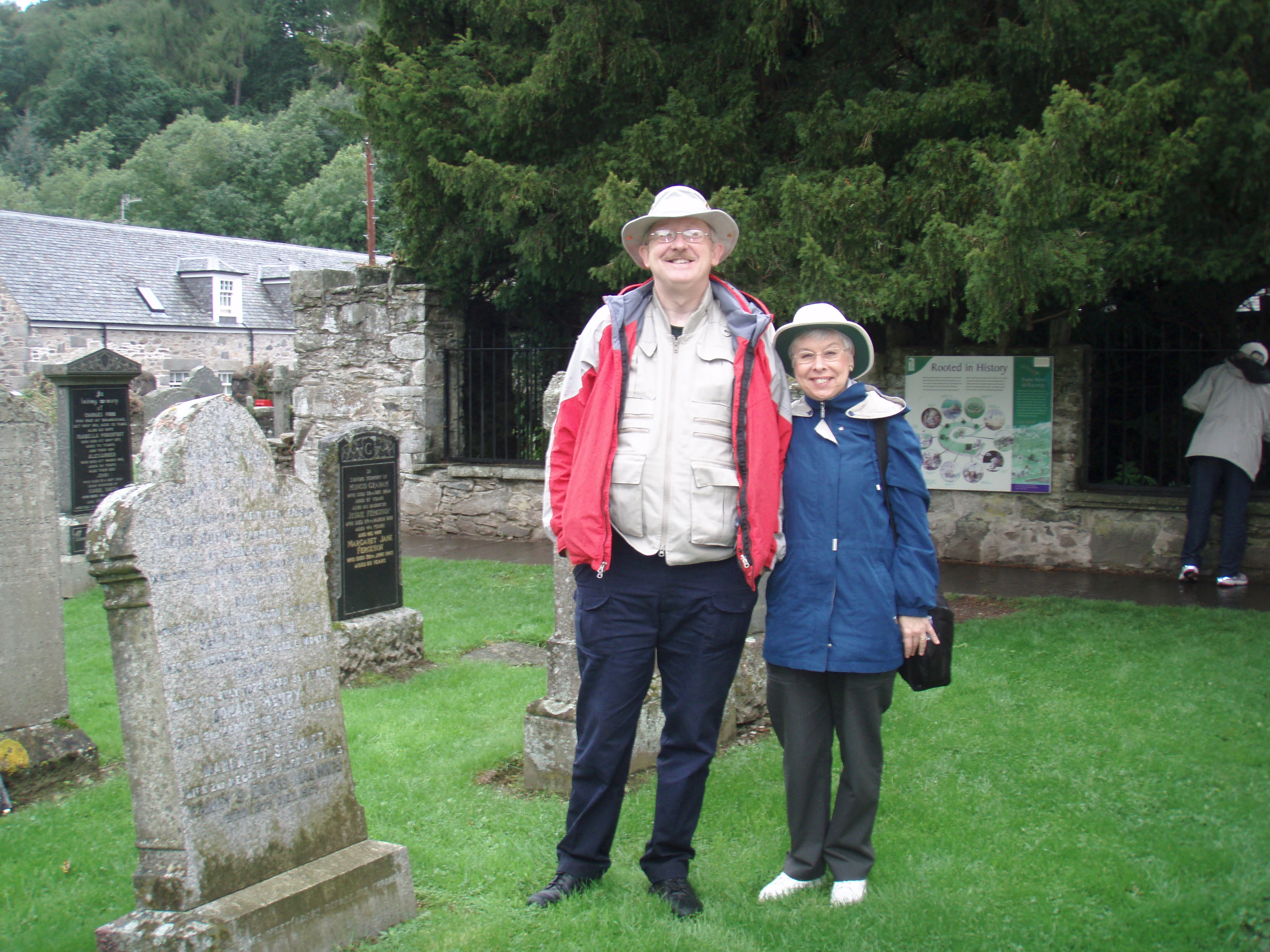 Colin & Jeanette Stevens in Fortingall church yard in front of the ancient yew tree.