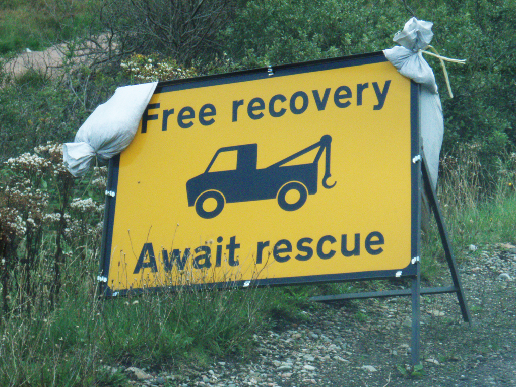 Highway sign FREE RECOVERY   AWAIT RESCUE, Glencoe, Scotland.