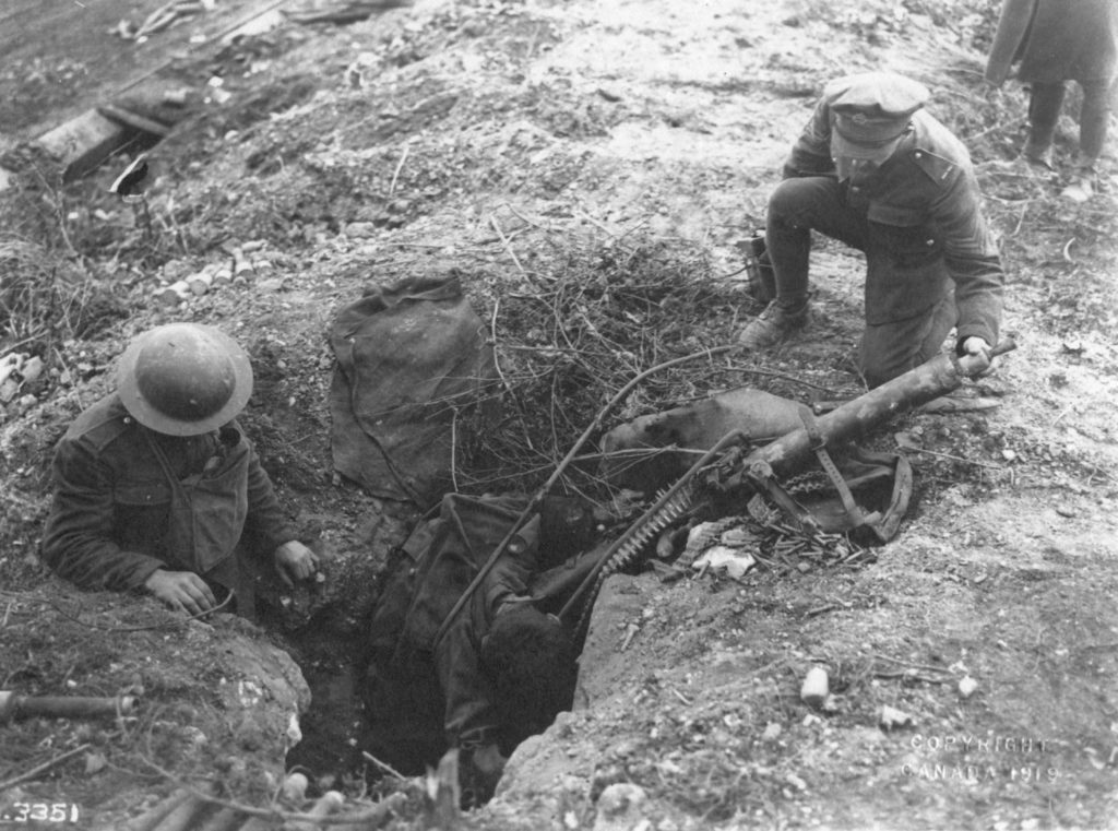 Photo O-3351 M.G. 08/ 15 On the banks of the Canal DuNord a dead German Machine Gunner, killed by advancing Canadians.
