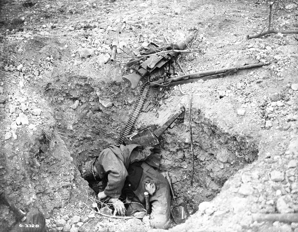 Photo O.2542 M.G. 08/15 Dead gunner. He was killed trying to stop the Canadian advance. Canal du Nord East of Arras November 1918