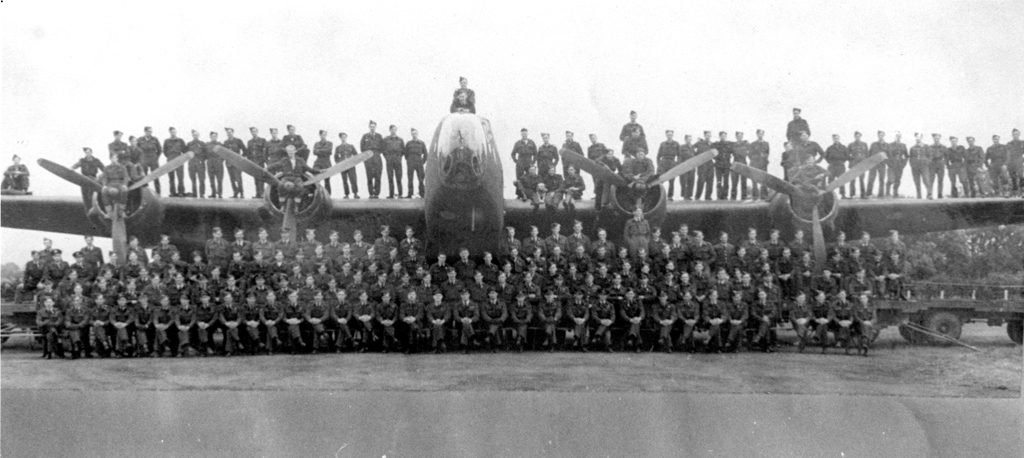 424 Sqn RCAF members on a Halifax bomber. Circa 1944.