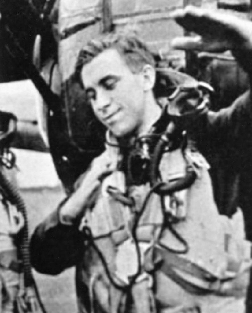 """J. W. """"Junior"""" Cumbers, air-gunner, shows how he shot down a FW-190 & Me109."""