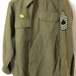 US Army WWII EM shirt with rank and discharge badge