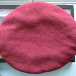 Dillon's maroon beret upper surface.