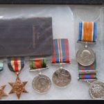 DILLON family medals. Two WWI medals for his father and five for him.