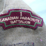 Original one of two 1 Canadian Parachute Battalion titles on Dillon's blouse.