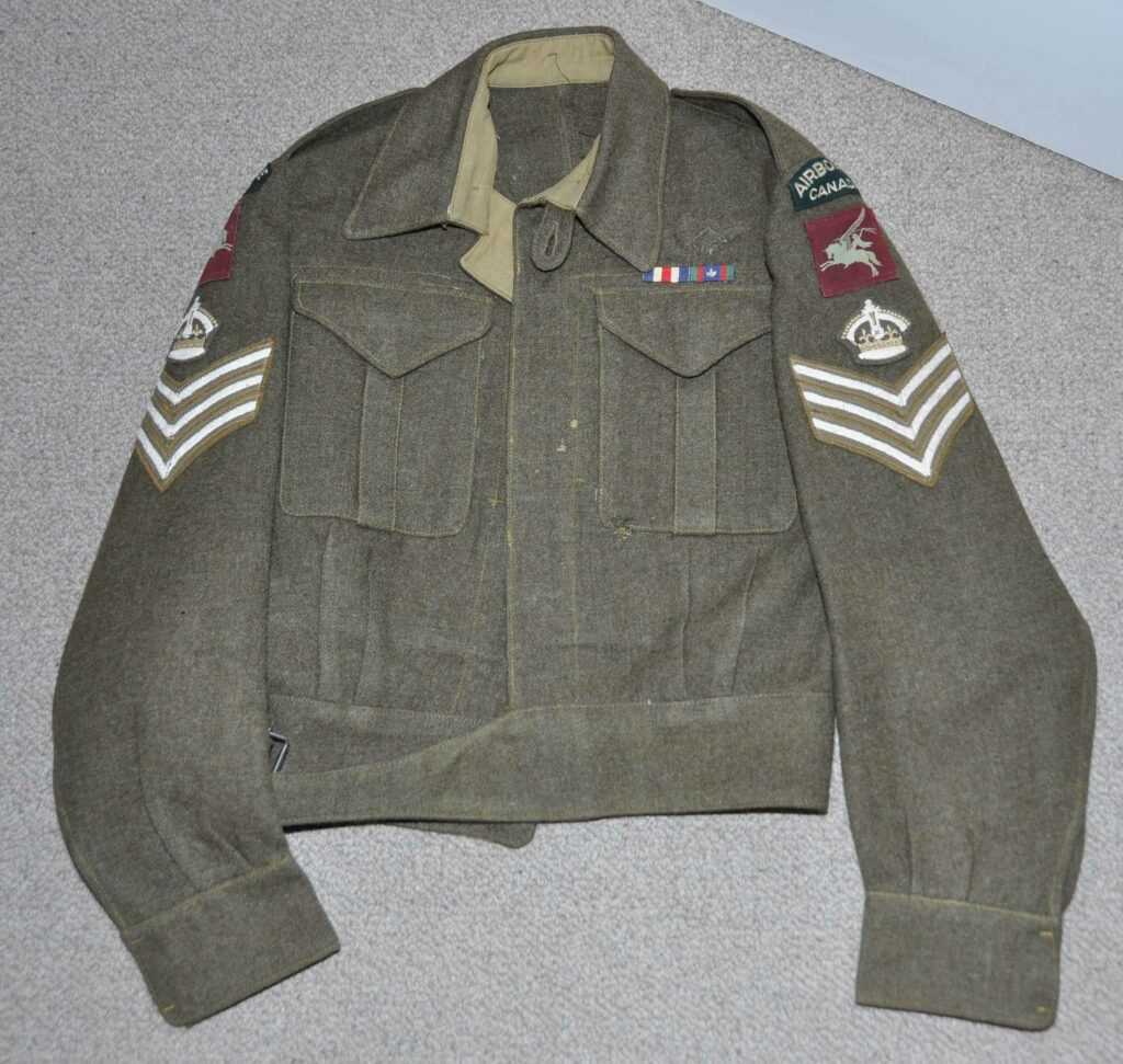 Battledress blouse Staff Sergeant, Airborne Canada. Found with the U.S. Parachutist Jacket and presumably from the same man. As found. Parachute badge had been removed. A replacement (age not guaranteed). MOTH DAMAGE to front of blouse.